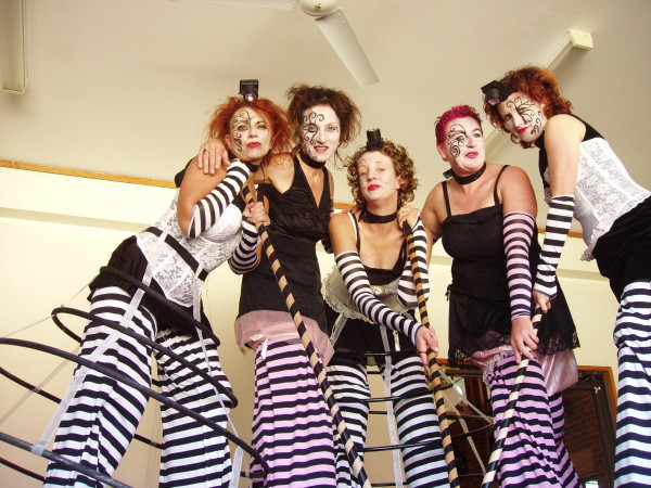 Corsets and stripes make these dramatic costumes sing and will add glamour and style to your event. Roving stilt performers. Concept, choreography and costume design by Mara Vukasinovic.